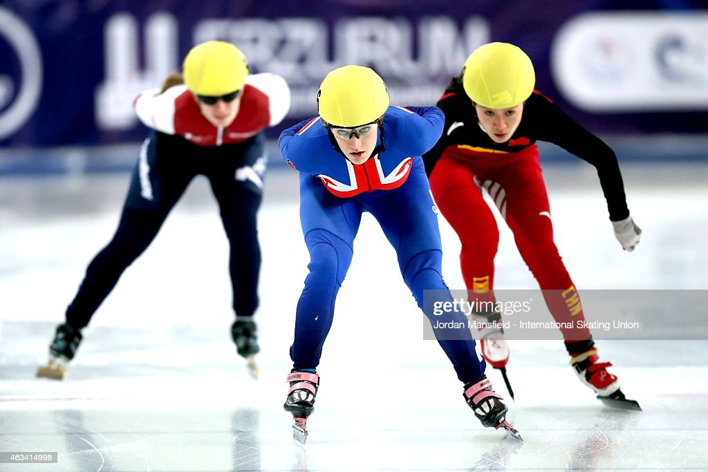 Elise Christie of Great Britain (C) competes in her Women's quarter-final race on day one of the ISU World Cup Short Track Speed Skating on February 14, 2015 in Erzurum, Turkey.