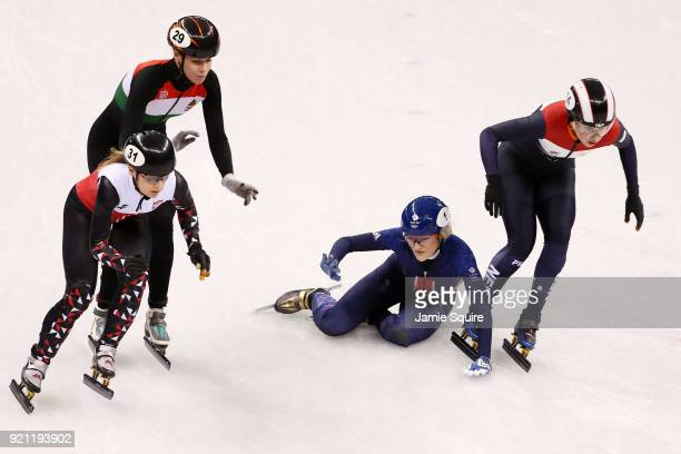 Elise Christie of Great Britain crashes out during the Ladies Short Track Speed Skating 1000m Heats on day eleven of the PyeongChang 2018 Winter...