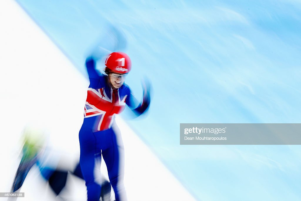 Elise Christie of Great Britain crosses the finish line and celebrates after winning the Ladies 500m final gold medal during day 2 of the ISU European Short Track Speed Skating Championships at The Sportboulevard on January 24, 2015 in Dordrecht, Netherlands.