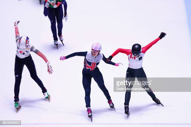 Elise Christie of Great Britain crosses the finish line first to take victory and winning the gold medal with Marianne StGelais of Canada in second...