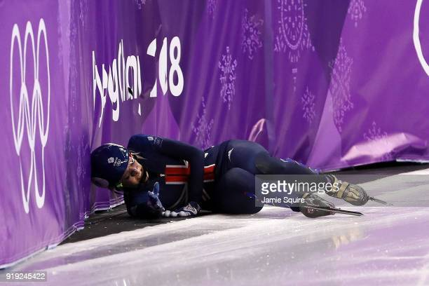 Elise Christie of Great Britain falls after a collision with Jinyu Li of China during the Short Track Speed Skating Ladies' 1500m Semifinals on day...