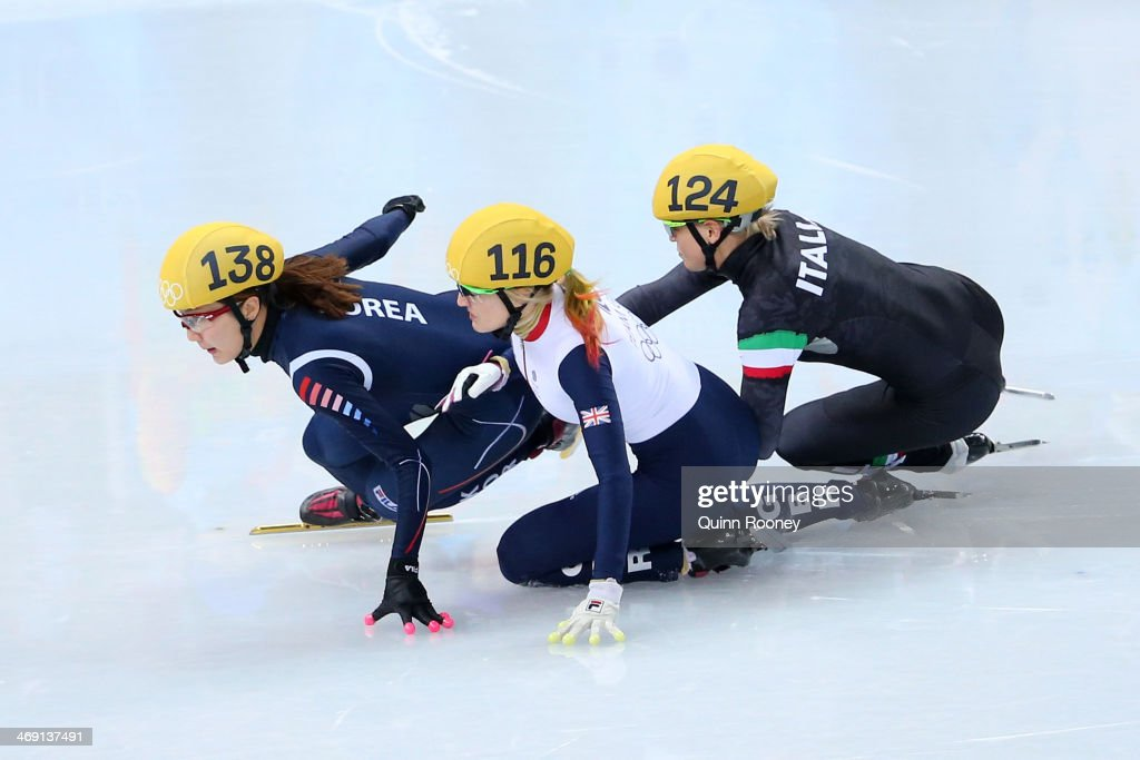 Elise Christie of Great Britain (C) falls and collides with Seung-Hi Park of South Korea (L) and Arianna Fontana of Italy (R) as she competes in the Short Track Speed Skating Ladies' 500 m Final on day 6 of the Sochi 2014 Winter Olympics at at Iceberg Skating Palace on February 13, 2014 in Sochi, Russia.