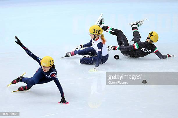 Elise Christie of Great Britain falls and collides with Seung-Hi Park of South Korea and Arianna Fontana of Italy as she competes in the Short Track...