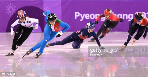 Elise Christie of Great Britain falls as Arianna Fontana of Italy and Minjeong Choi of Korea race past during the Ladies' 500m Short Track Speed...