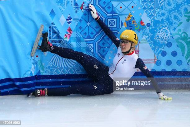 Elise Christie of Great Britain hits the wall while competing in the Short Track Women's 1000m Semifinals on day fourteen of the 2014 Sochi Winter...
