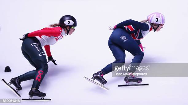 Elise Christie of Great Britain in action and goes on to cross the finish line first to take victory and winning the gold medal with Marianne...