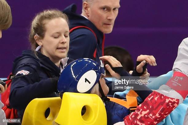 Elise Christie of Great Britain is carted off the ice on a stretcher after a fall during the Short Track Speed Skating Ladies' 1500m Semifinals on...