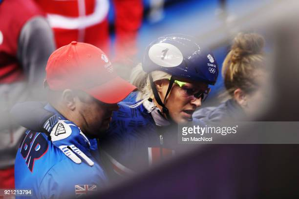 Elise Christie of Great Britain is helped from the Ice Rink after competing in the heats of the Women's 1000m at Gangneung Ice Arena on February 20...