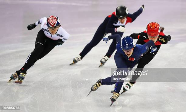 Elise Christie of Great Britain is seen racing Chunyu Qu of China during the Women's 500m heats of the Short Track Speed Skating on day one of the...
