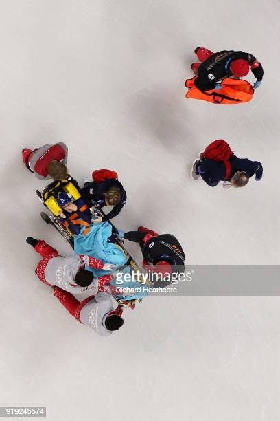 Elise Christie of Great Britain is taken off the ice on a stretcher after a collision during the Short Track Speed Skating Ladies' 1500m Semifinals...