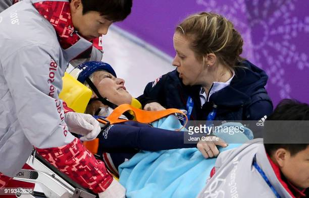 Elise Christie of Great Britain is tended to and leaves the ice on a stretcher after a fall during the Short Track Speed Skating Ladies' 1500m...