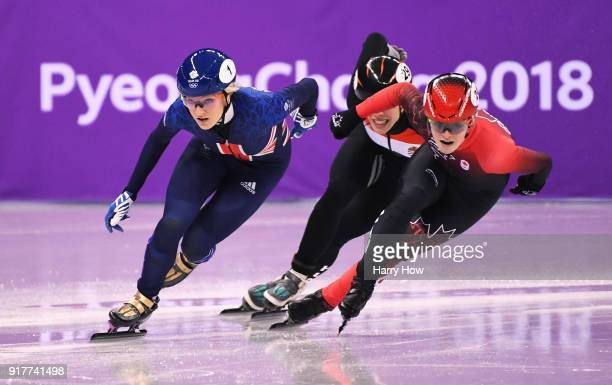 Elise Christie of Great Britain Kim Boutin of Canada and Andrea Keszler of Hungary compete during the Ladies' 500m Short Track Speed Skating...