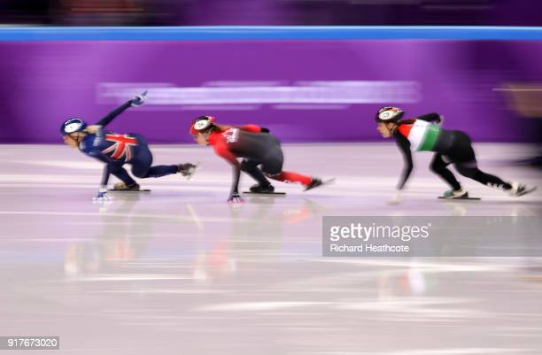 Elise Christie of Great Britain Kim Boutin of Canada Andrea Keszler of Hungary compete during the Ladies' 500m Short Track Speed Skating quarterfinal...
