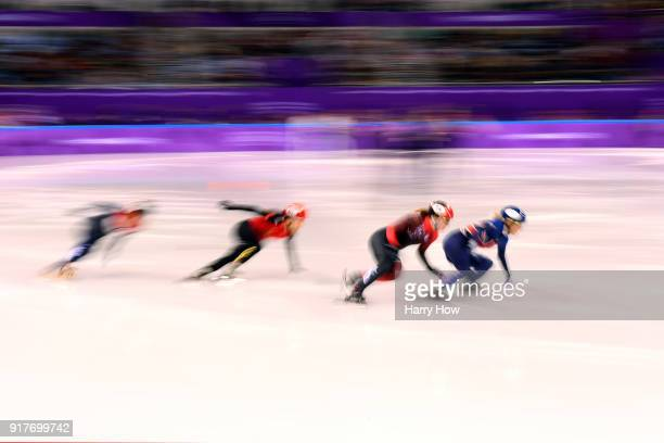 Elise Christie of Great Britain Kim Boutin of Canada Yara Van Kerkhof of the Netherlands and Chunyu Qu of China compete during the Ladies' 500m Short...