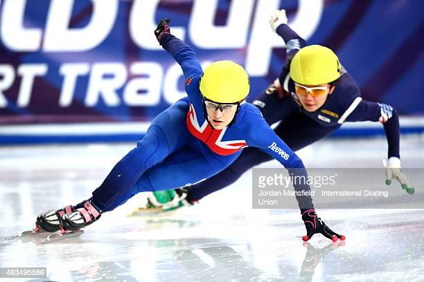 Elise Christie of Great Britain leads Suk Hee Shim of Korea into the first corner during the Women's 500m quarterfinals on day two of the ISU World...