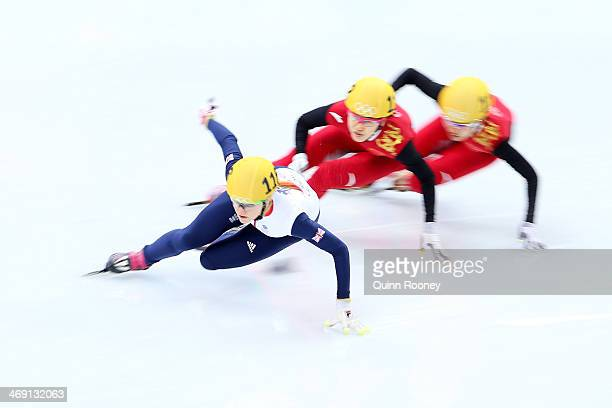 Elise Christie of Great Britain Qiuhong Liu of China and Jianrou Li of China compete in the Short Track Speed Skating Ladies' 500m Semifinal on day 6...