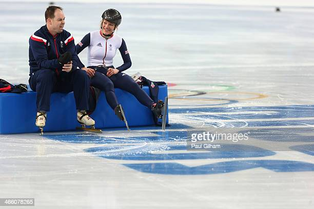 Elise Christie of Great Britain talks to one of the Great Britain coaches during a Team Great Britain training session at the Iceberg Skating Palace...