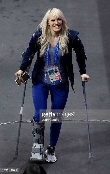 Elise Christie of Great Britain with crutches wearing a cast on her right foot looks on after attending the venue victory ceremony with her boyfriend...
