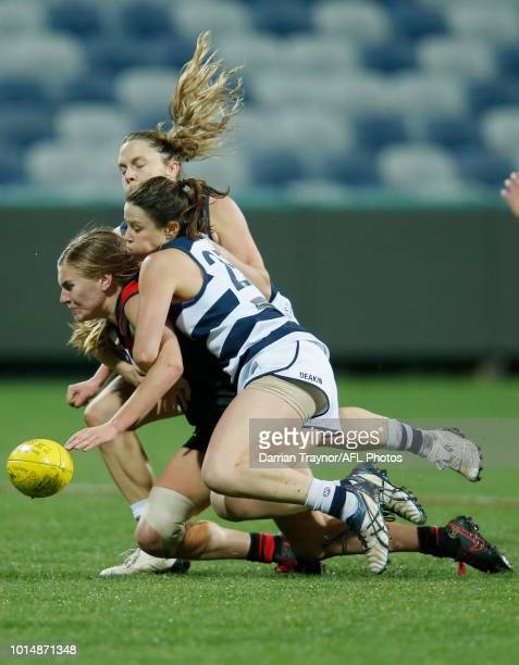 Elise Coventry of Geelong tackles Alexa Madden of Essendon during the round 14 VFLW match between the Essendon Bombers and the Geelong Cats at GMHBA...
