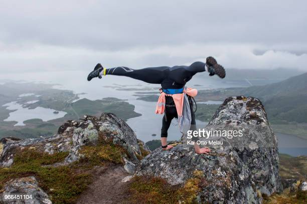 Elise DahlHansen does a handstand during The Arctic Triple Lofoten UltraTrail on June 2 2018 in Svolvar Norway Lofoten UltraTrail is one of three...