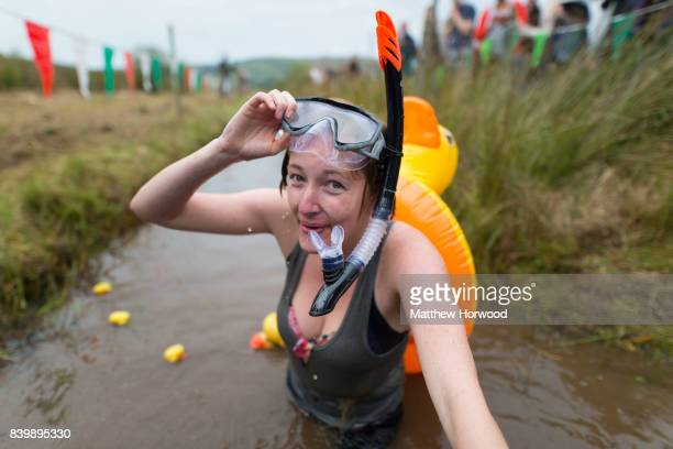Elise Graham takes part in the World Bog Snorkelling Championships 2017 with a rubber duck on her back on August 27 2017 in Llanwrtyd Wells Wales The...