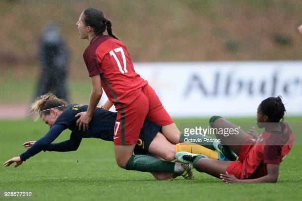 Elise KellondKnight of Australia competes for the ball with Vanessa Marques of Portugal during the 3rd place playoff Women's Algarve Cup Tournament...