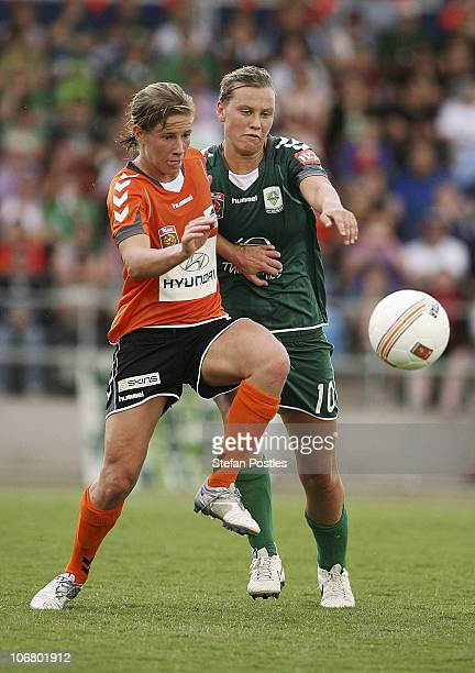 Elise KellondKnight of the Roar and Emily Van Egmond challenge for the ball during the round two WLeague match between Canberra United and the...