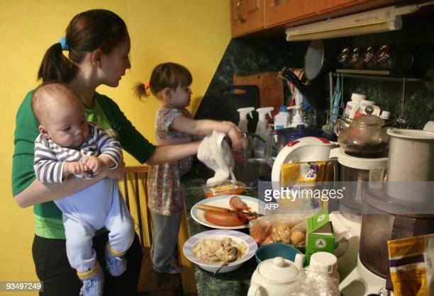 Elise MENAND Russian HIVpositive mother of two Svetlana Izambayeva cooks a meal with her children Adam and Eva at their apartment in Kazan on...