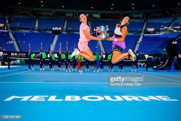 Elise Mertens , Aryna Sabalenka pose with the trophy after winning a tennis match between Belgian-Belarussian pair Mertens-Sabalenka and Czech pair...
