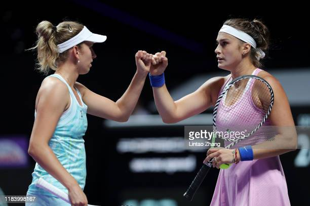 Elise Mertens of Belgium and Aryna Sabalenka of Belarus celebrate a point against AnnaLena Groenefeld of Germany and Demi Schuurs of the Netherlands...