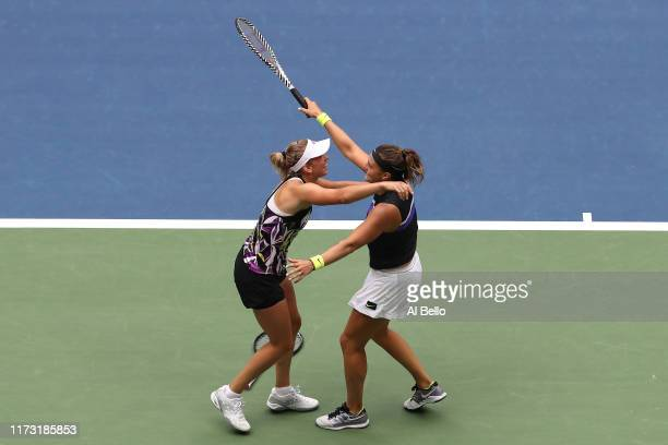 Elise Mertens of Belgium and Aryna Sabalenka of Belarus celebrate after winning their Women's Double's final match against Victoria Azarenka of...