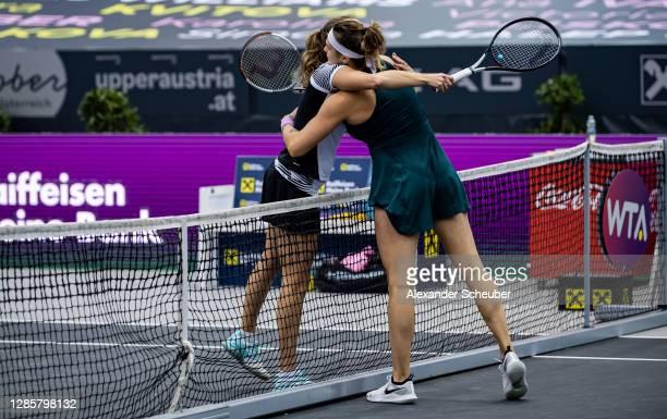 Elise Mertens of Belgium and Aryna Sabalenka of Belarus hug each other during the finals of the Upper Austria Ladies Linz at TipsArena on November...