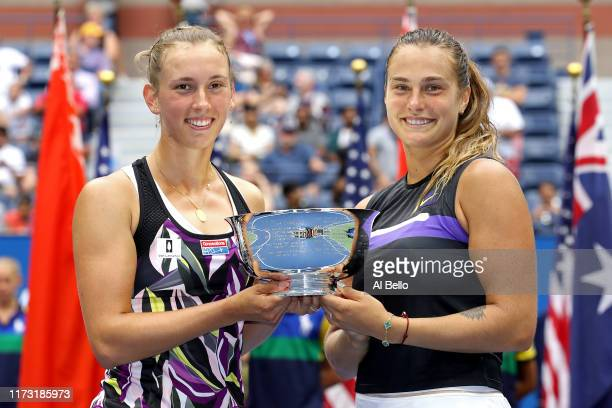 Elise Mertens of Belgium and Aryna Sabalenka of Belarus pose with the trophy after winning their Women's Double's final match against Victoria...