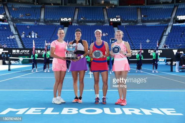 Elise Mertens of Belgium and Aryna Sabalenka of Belarus pose with the championship trophy alongside runners up Barbora Krejcikova of the Czech...