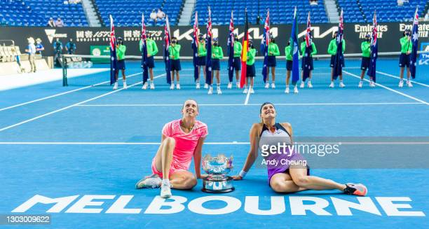 Elise Mertens of Belgium and Aryna Sabalenka of Belarus pose with the championship trophy after winning their Women's Doubles Final match against...