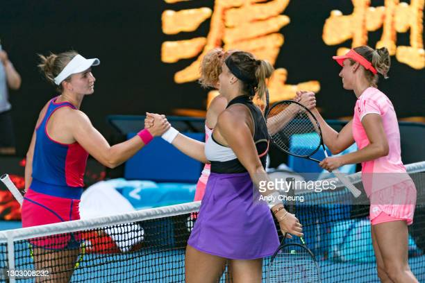Elise Mertens of Belgium and Aryna Sabalenka of Belarus shake hands with Barbora Krejcikova of the Czech Republic and Katerina Siniakova of the Czech...