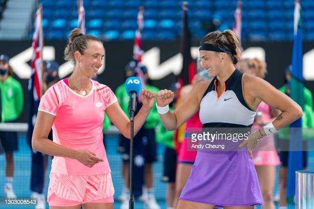 Elise Mertens of Belgium and Aryna Sabalenka of Belarus speak during the trophy presentation after winning their Women's Doubles Final match against...