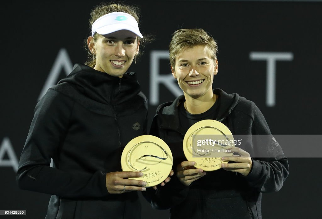 Elise Mertens of Belgium and Demi Schuurs of the Netherlands pose after winning the doubles final againsts Lyudmyla Kichenok of the Ukraine and Makoto Ninomiya of Japan at the 2018 Hobart International at Domain Tennis Centre on January 13, 2018 in Hobart, Australia.