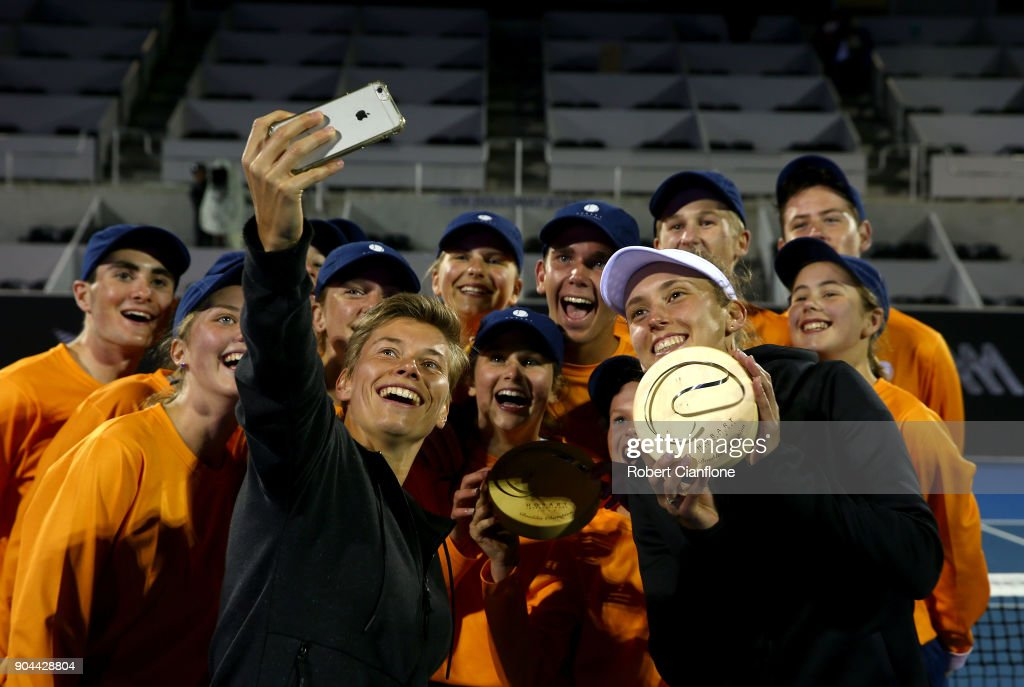 Elise Mertens of Belgium and Demi Schuurs of the Netherlands take a selfie after winning the doubles final againsts Lyudmyla Kichenok of the Ukraine and Makoto Ninomiya of Japan at the 2018 Hobart International at Domain Tennis Centre on January 13, 2018 in Hobart, Australia.