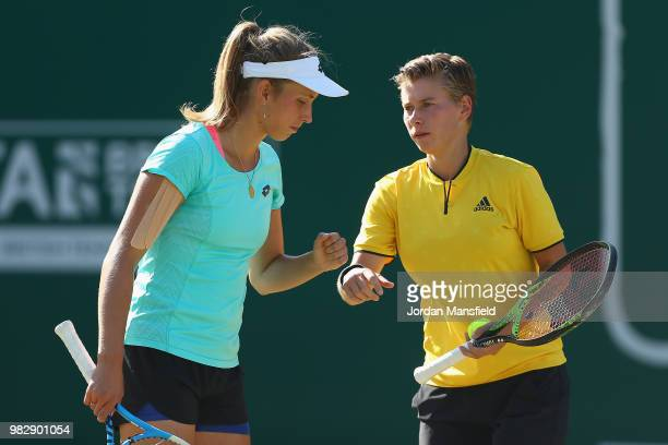Elise Mertens of Belgium and Demi Schuurs of the Netherlands talk tactics during their doubles Final match against Kristina Mladenovic of France and...