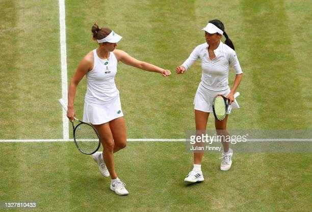 Elise Mertens of Belgium and playing partner Su-Wei Hsieh of Taiwan celebrate in their Ladies' Doubles Semi-Final match against Shuko Aoyama and Ena...