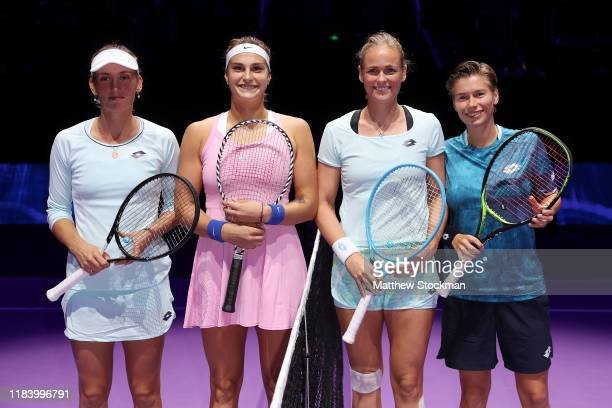Elise Mertens of Belgium Aryna Sabalenka of Belarus AnnaLena Groenefeld of Germany and Demi Schuurs of the Netherlands pose for a photo prior to...