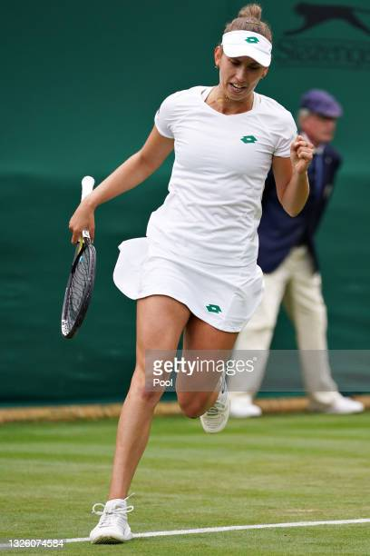 Elise Mertens of Belgium celebrates after winning a point in her Ladies' Singles First Round match against Harriet Dart of Great Britain during Day...
