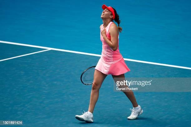 Elise Mertens of Belgium celebrates after winning match point in her Women's Singles third round match against Belinda Bencic of Switzerland during...