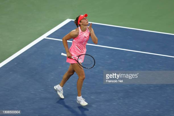 Elise Mertens of Belgium celebrates victory after winning her Quarter-Final singles match against Jessica Pegula of The United States during Day Five...