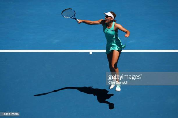 Elise Mertens of Belgium celebrates winning match point in her quarterfinal match against Elina Svitolina of Ukraine on day nine of the 2018...
