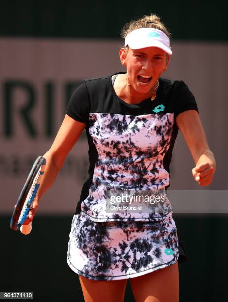 Elise Mertens of Belgium celebrates winning the first set during her ladies singles second round match against Heather Watson of Great Britain during...