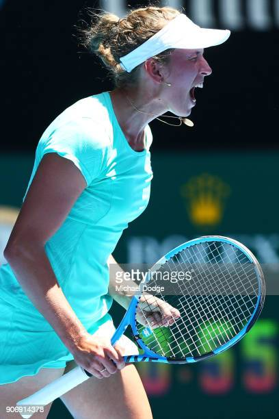 Elise Mertens of Belgium celebrates winning the first set in her third round match against Alize Cornet of France on day five of the 2018 Australian...