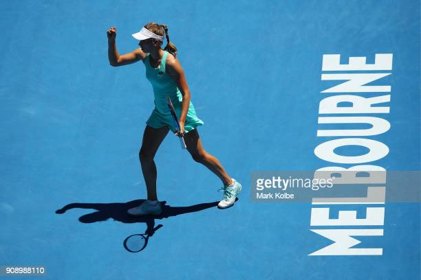 Elise Mertens of Belgium celebrates winning the first set in her quarterfinal match against Elina Svitolina of Ukraine on day nine of the 2018...