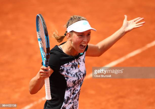 Elise Mertens of Belgium celebrates winning the match during her ladies singles second round match against Heather Watson of Great Britain during day...